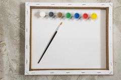 Flatlay with empty white mock up back of canvas, paints and brush on grey cement background, Artist, drawing royalty free stock images
