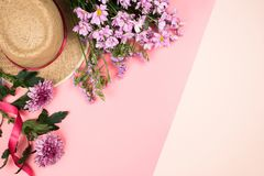 Flatlay frame arrangement with pink chrysanthemum flowers and daisies. And a straw hat, pastel background. Copyspace Royalty Free Stock Images