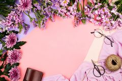 Flatlay frame arrangement with pink chrysanthemum flowers and daisies and other accessories. Flatlay frame arrangement with pink chrysanthemum flowers and Stock Photography