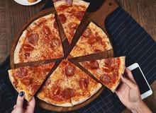 Flatlay. Friends eat pizza. Stock Photography