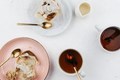 Flatlay of homemade cinnamon rolls with cream and tea royalty free stock photography