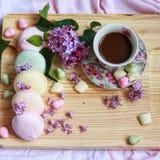 Flatlay macarons. Macaronsandflowers spring inspiration breakfast wood woodworking  coffee cofe latte cappucino tender foodphoto foodfoto flat Royalty Free Stock Image