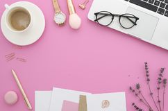 Flat lay mockup female workspace with women`s office desk laptop, lavender, makeup accessories, notebook, glasses stock photography