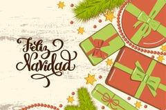 Flatlay modell med gran, ljusa gåvaaskar med pilbågen, pärlor och stjärnor på lantlig bakgrund med att märka Feliz Navidad Merry royaltyfri illustrationer