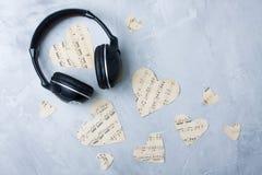 Flatlay music composition headphones paper hearts gray concrete Stock Image