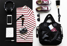 Flatlay of outfit for travel stock photography