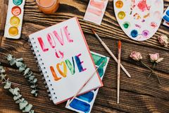 Flatlay of sketchbook with handlettering inscription stock images
