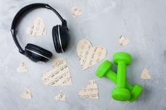 Flatlay sport music composition headphones paper hearts dumbbell Stock Images
