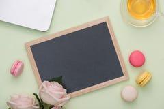 Flatlay of sweet macaroons and blank board.  stock photo