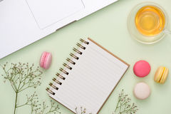 Flatlay of sweet macaroons and open notebook. Stock Photography