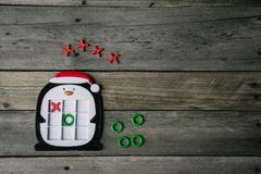 Holiday Penguin Tic Tac Toe Game Left of Center royalty free stock photos
