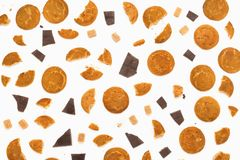 Flatlay of various sweets. Cookies, chocolate, sugar cubes on white. Top view stock photography