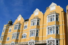 Flats and blue sky. These lovely Victorian flats in Brighton on a clear blue sunny day royalty free stock images