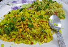 Poha and Fried Rice. Flatten rice aka poha and fried rice for a healthy breakfast, seasoned with vegetables and lemon Royalty Free Stock Image