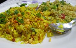 Poha and Fried Rice. Flatten rice aka poha and fried rice for a healthy breakfast, seasoned with vegetables and lemon Stock Images