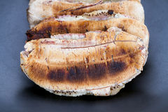 Flatten roasted banana on black plate Royalty Free Stock Images