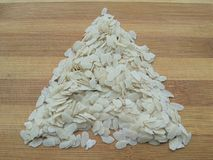 Flattened rice triangle on wooden background Stock Images