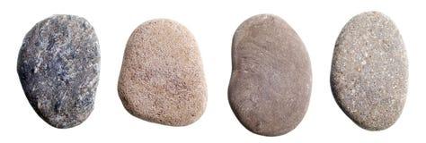 Flattened river rocks isolated on white stock photo