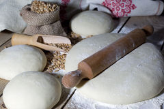 Flattening a Dough with Rolling Pin Closeup Royalty Free Stock Photos