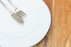 Flatware. Fish  fork and fish  knife  on a plate Stock Photos