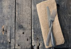 Flatware on a table. Flatware on a rustic wooden table with space for text stock images