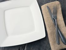 Flatware on a table. Flatware on a rustic wooden table with space for text royalty free stock images