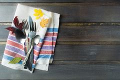 Flatware serving on tissue ready for eating over wooden table Stock Photo