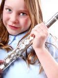 Flauta da terra arrendada da rapariga imagem de stock royalty free