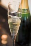 Flauta de champán con el corcho y la botella Fotos de archivo libres de regalías