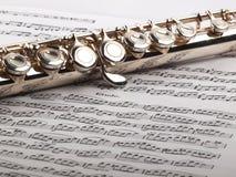 Flauta y notas Fotos de archivo