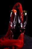 Flautas y fresa de champán Foto de archivo libre de regalías
