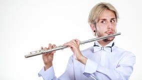 Flautista de sexo masculino que toca su flauta Fotos de archivo libres de regalías