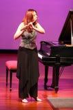 Flautista hermoso Imagen de archivo libre de regalías