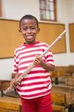 Flauto felice della tenuta dell'allievo Fotografia Stock Libera da Diritti