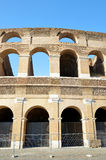 Flavian Amphitheatre or Colosseum in Rome. With blue sky in the background, Italy Stock Image