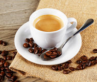 Flavor of coffee. Composition of coffee cup on wood background stock photography