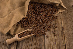 Flavor of coffee and wooden background. Selective focus Stock Photography