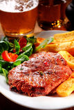 Flavored Beef Steak and Fries on Plate Stock Image