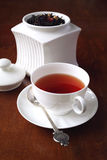 Flavored black tea in white porcelain dish Stock Images
