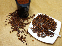 Flavored coffee beans and coffee grinder Royalty Free Stock Photo
