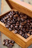 Flavored coffee beans in a wooden  box Stock Photos