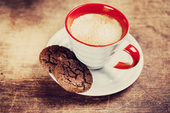 Flavored coffee with chocolate biscuits Royalty Free Stock Images