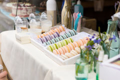 Flavored colorful French macarons on a sale Stock Image