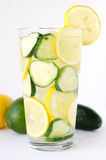 Flavored cucumber and lemon water. Cucumbers and lemon lime flavored water on white background stock images
