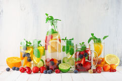 Flavored fruit infused water Stock Photos
