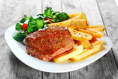 Flavored Grilled Meat with French Fries on Plate Royalty Free Stock Images