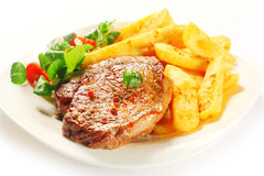 Flavored Grilled Meat with French Fries on Plate Stock Photography