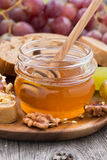 Flavored honey, bread with butter and grapes, vertical Royalty Free Stock Photos