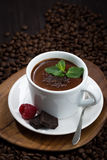 flavored hot chocolate on a background of coffee beans, vertical Royalty Free Stock Photos