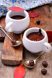 Flavored hot chocolate in small ceramic chashkahna Stock Photography
